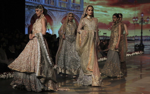 Models present creations of designer Umsha by Uzama Babar during Bridal Couture Week 2016 in Lahore, Pakistan, Sunday, November 27, 2016. (Photo by K.M. Chaudary/AP Photo)