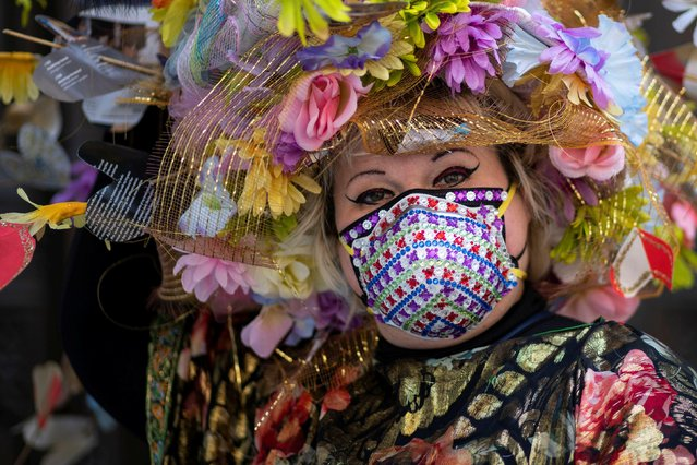 A woman attends the annual Easter Parade and Bonnet Festival on Fifth Avenue, amid the coronavirus disease (COVID-19) pandemic, in New York City, U.S., April 4, 2021. (Photo by Eduardo Munoz/Reuters)