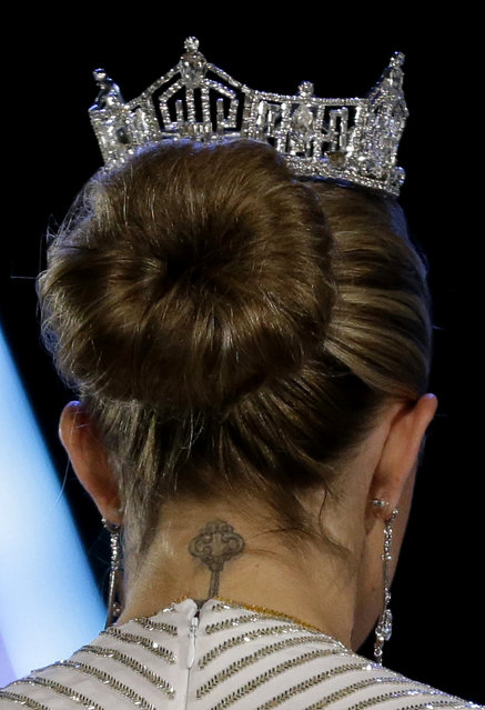 A tattoo is seen on the neck of Miss America 2013 Mallory Hagan during the Miss America 2014 pageant, Sunday, September 15, 2013, in Atlantic City, N.J. (Photo by Julio Cortez/AP Photo)