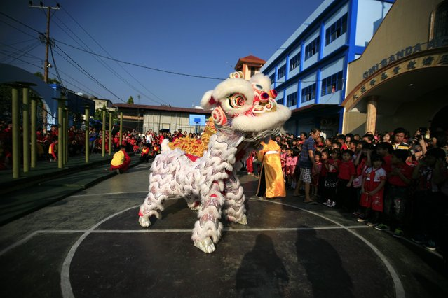 A group of dancer performs a lion dance to celebrate the coming of the Chinese Lunar New Year in Banda Aceh, Indonesia, 14 February 2015. (Photo by Hotli Simanjuntak/EPA)