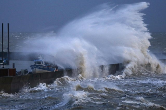 Waves crash on the protecting wall at the fishing harbour in Pornic, France as stormy weather with high winds hits the French Atlanitic coast January 11, 2016. (Photo by Stephane Mahe/Reuters)