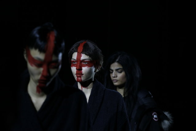 A model wears an outfit by designer Gareth Pugh during the rehearsal before his Autumn/Winter 2015 show at London Fashion Week, in London, Saturday, February 21, 2015. (Photo by Alastair Grant/AP Photo)