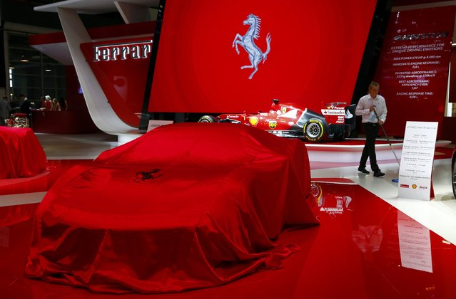 A veiled Ferrari 488 GTB is seen during the first press day ahead of the 85th International Motor Show in Geneva March 3, 2015.  REUTERS/Arnd Wiegmann