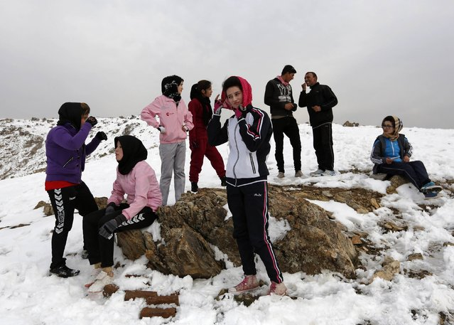 Members of Afghanistan's Women's National Cycling Team are seen during an exercise on a snowy mountain in Qargha on the outskirts of Kabul March 9, 2015. (Photo by Mohammad Ismail/Reuters)