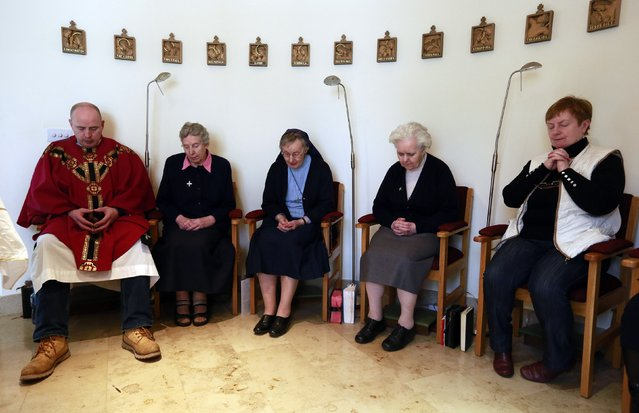 Fr Pierre Pepper takes part in a private mass for Nuns in La Sainte Union Des Sacres Coeurs Convent in the village of Banagher County Offaly March 2, 2015. (Photo by Cathal McNaughton/Reuters)