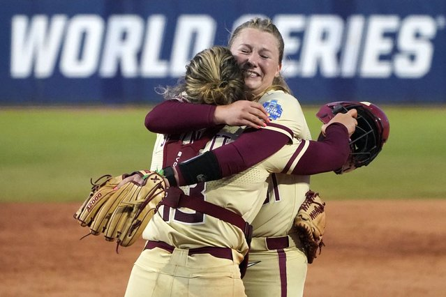 Florida State pitcher Danielle Watson, right, hugs catcher Anna Shelnutt, left, after defeating Alabama in an NCAA Women's College World Series softball game Monday, June 7, 2021, in Oklahoma City. Florida State moves onto the championship finals series. (Photo by Sue Ogrocki/AP Photo)