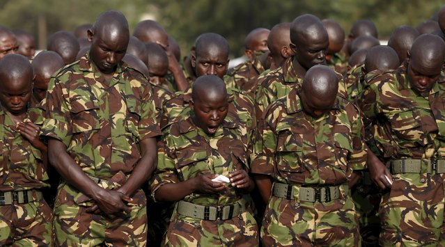 A member of the Kenya Defence Forces yawns as they attend prayers to pay their respects to the Kenyan soldiers serving in the African Union Mission in Somalia (AMISOM), who were killed in El Adde during an attack, at a memorial mass at the Moi Barracks in Eldoret, January 27, 2016. Al Shabaab, which is aligned with al Qaeda, said its fighters killed more than 100 Kenyan soldiers when they overrun the base in El Adde, also known as Ceel Cadde, near the Kenyan border, on January 15. (Photo by Thomas Mukoya/Reuters)