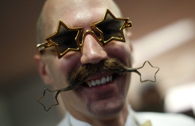 Daniel Lablor of the U.S. poses with his beard art work before the Beard World Championship 2013 in Leinfelden-Echterdingen near Stuttgart November 2, 2013. More than 300 people from around the world compete in different moustache and beard categories. (Photo by Michaela Rehle/Reuters)