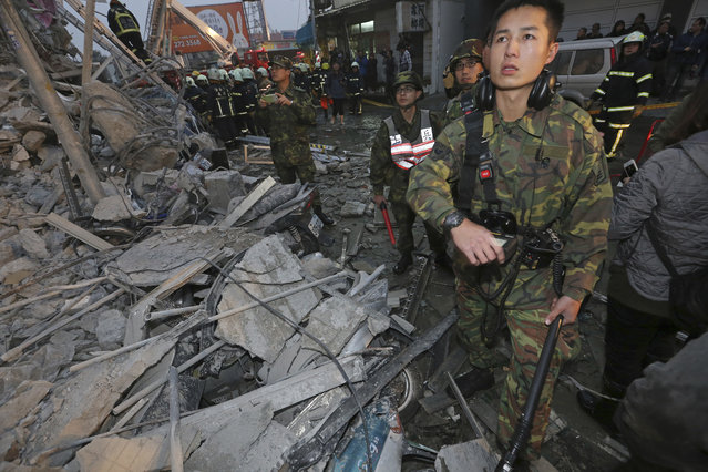 Army soldiers search a toppled building an earthquake in Tainan, Taiwan, Saturday, February 6, 2016. (Photo by AP Photo)