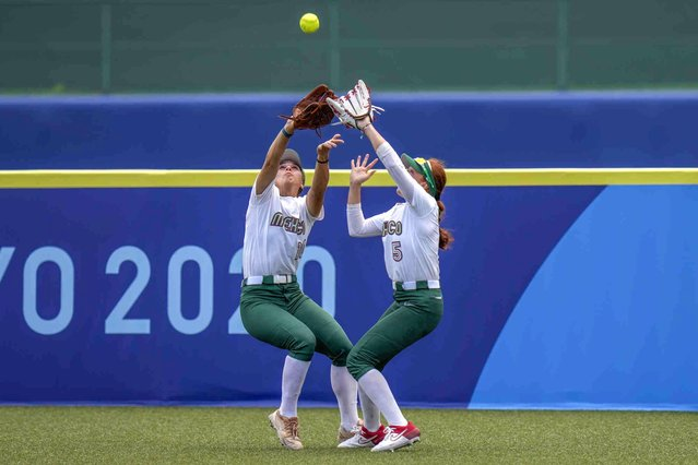 Mexico's Nicole Rangel, left, and Suzannah Brookshire collide as they attempt to take a catch during the softball game between the Mexico and Japan at the 2020 Summer Olympics, Thursday, July 22, 2021, in Fukushima , Japan. (Photo by Jae C. Hong/AP Photo)