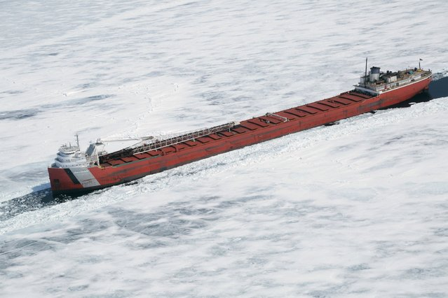 The John G. Munson Lake Freighter is shown trapped in ice in this aerial photo near Whitefish Bay on Lake Superior northwest of Sault Ste. Marie, Ontario April 7, 2015. (Photo by Kenneth Armstrong/Reuters)