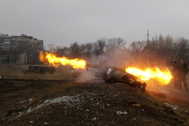 A volunteer of the separatist self-proclaimed Donetsk People's Republican guard fires a Konkurs wire-guided anti-tank missile  during shooting training in Donetsk March 1, 2015. (Photo by Baz Ratner/Reuters)