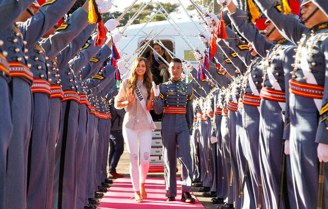 Miss Universe contestant Caris Tiivel of Australia is greeed by cadets of the Philippine Military Academy (PMA) during her arrival at the airport in Baguio city, north of Manila, Philippines January 18, 2017. (Photo by Harley Palanchao/Reuters)