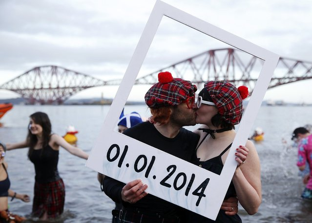 Swimmers in fancy dress participate in the New Year's Day Looney Dook swim at South Queensferry, Scotland January 1, 2014. (Photo by Russell Cheyne/Reuters)