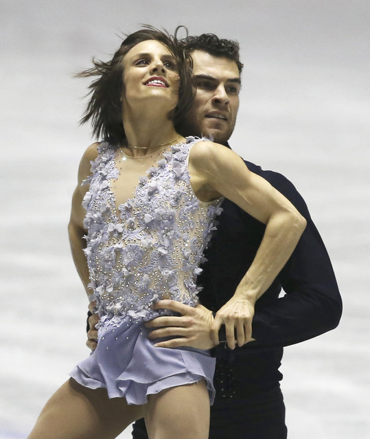 Meagan Duhamel and Eric Radford of Canada perform during the pairs short program at the World Team Trophy Figure Skating Championships in Tokyo, Friday, April 17, 2015. (Photo by Koji Sasahara/AP Photo)