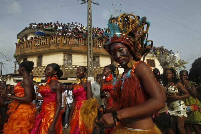 Women take part in a parade during the Popo (Mask) Carnival of Bonoua, in the east of Abidjan, April 18, 2015. (Photo by Luc Gnago/Reuters)