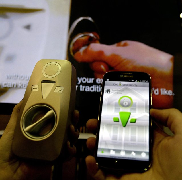 Thew OK-I-Dokeys smart lock controlled by a smart phone is shown during the Unveiled press preview event for the 2014 International Consumer Electronics Show (CES) at the Mandalay Bay Convention Center in Las Vegas, Nevada, USA, 06 January 2014. (Photo by Michael Nelson/EPA)