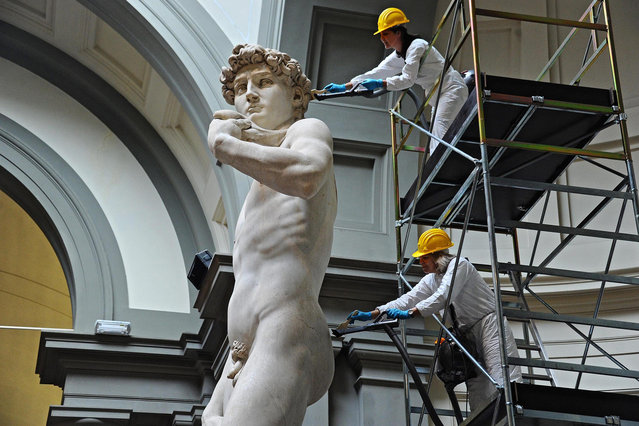 Michelangelo's David undergoes cleaning operations and half-yearly maintenance at the Accademia Gallery in Florence, Italy, 29 February 2016. The marble statue was created between 1501 and 1504. (Photo by Maurizio Degl' Innocenti/EPA)