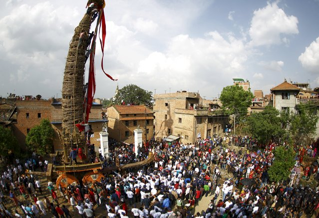 Devotees gather around the chariot of Rato Machhindranath during the chariot festival at Bungamati in Lalitpur April 22, 2015. (Photo by Navesh Chitrakar/Reuters)
