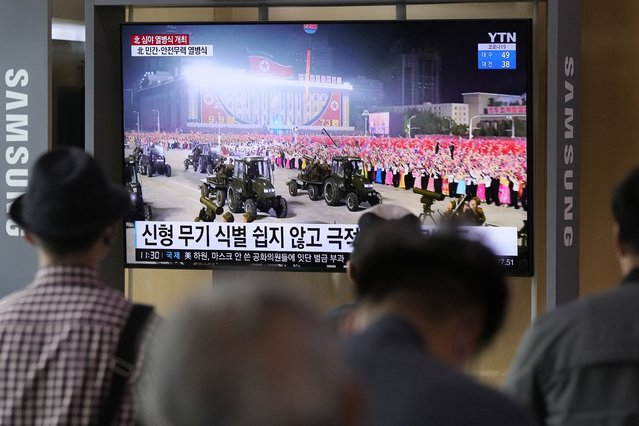 People watch a TV showing a military parade held in Pyongyang, North Korea, at Seoul Railway Station in Seoul, South Korea, Thursday, September 9, 2021. North Korea paraded goose-stepping soldiers and military hardware in its capital overnight in a celebration of the nation's 73rd anniversary that was overseen by leader Kim Jong Un, state media reported Thursday. (Photo by Ahn Young-joon/AP Photo)