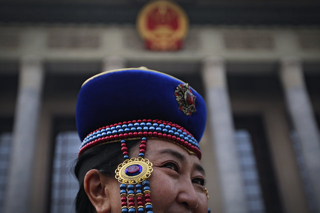 A minority delegate looks as she arrives at the Great Hall of the People to attend the opening session of the Chinese People's Political Consultative Conference (CPPCC) in Beijing, Sunday, March 3, 2019. (Photo by Andy Wong/AP Photo)