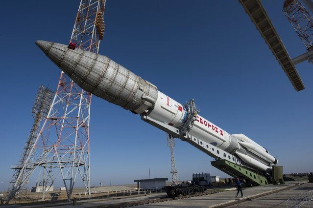 The Proton rocket, that will launch the ExoMars 2016 spacecraft to Mars, is lifted on the launchpad at the Baikonur cosmodrome, Kazakhstan, in this handout photo released by European Space Agency (ESA) on March 11, 2016. (Photo by Stephane Corvaja/Reuters/ESA)