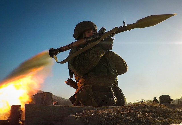 A marine aims an RPG-7, a portable rocket- propelled grenade launcher, during military exercises conducted by the Russian Pacific Fleet' s naval infantry unit at the Bamburovo firing range on February 2, 2017. (Photo by Yuri Smityuk/TASS)
