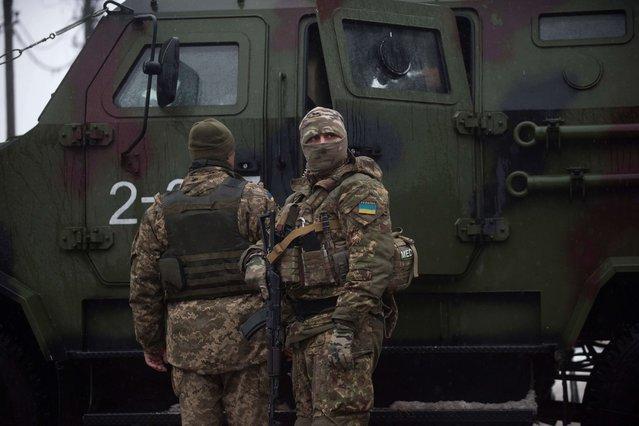 Ukrainian servicemen patrol near the humanitarian aid center in Avdiivka, Ukraine, Saturday, February 4, 2017. (Photo by Evgeniy Maloletka/AP Photo)