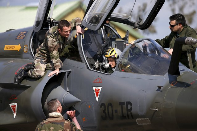 Technicians work on a Mirage 2000 fighter jet during the close air support (CAS) exercise Serpentex 2016 hosted by France in the Mediterranean island of Corsica, at Solenzara air base, March 16, 2016. (Photo by Charles Platiau/Reuters)