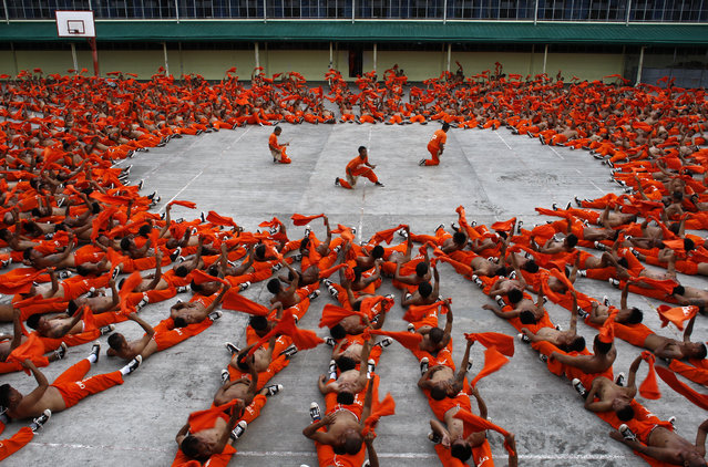 Prisoners dance during an exercise program at the Cebu Provincial Detention and Rehabilitation Center (CPDRC) in Cebu City, south of Manila, April 26, 2008. The prisoners' dancing exercises were made famous after a video of them was posted on the Internet. (Photo by Darren Whiteside/Reuters)