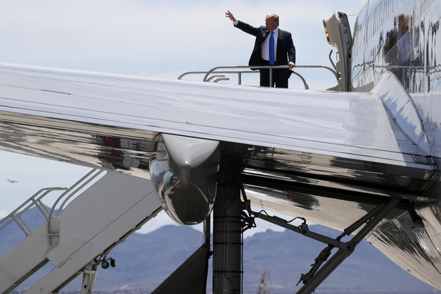 President Donald Trump waves from the top of the stairs of Air Force One as he leaves Las Vegas after speaking at the Republican Jewish Coalition's annual leadership meeting, Saturday April 6, 2019, en route to Washington. (Photo by Jacquelyn Martin/AP Photo)