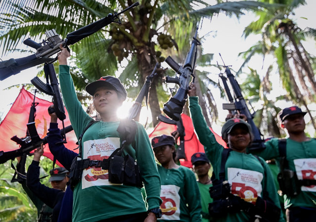 Fighters of the New People's Army-Melito Glor Command (NPA-MGC) conduct a drill during their 50th founding anniversary celebration at an undisclosed location in the mountains of Sierra Madre, Philippines, 31 March 2019. The rebellion has left about 40,000 combatants and civilians dead. It has stunted economic development, especially in the countryside, where the military says about 3,500 insurgents are still active. (Photo by Alecs Ongcal/EPA/EFE)