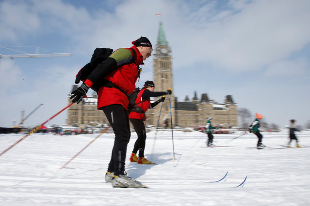 People cross-country ski on the front lawn of Parliament Hill during an event to promote fitness in Ottawa, Ontario, Canada February 15, 2017. (Photo by Chris Wattie/Reuters)