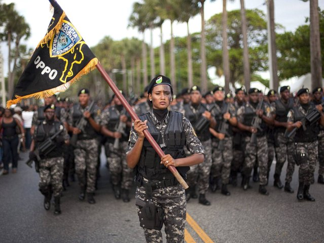 Members of the Dominican Armed Forces march on the streets of Santo Domingo, on February 27, 2014. (Photo by Orlando Barria/EPA)