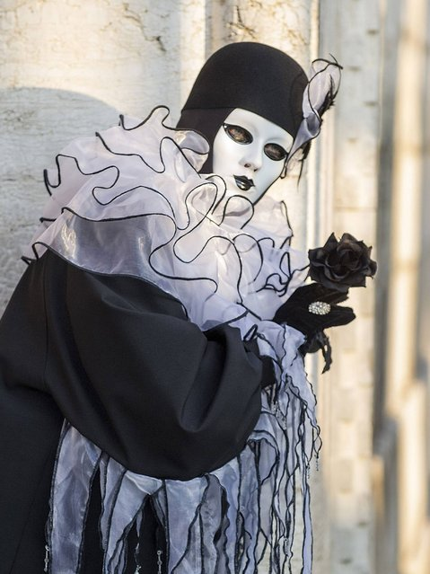 The Carnival of Venice costumes are famous all over the world and include ornate gowns and flowing cloaks, as well as many different masks that can be purchased from temporary stalls or from celebrated artisans who still make them by hand. (Photo by Marco Secchi/Getty Images)