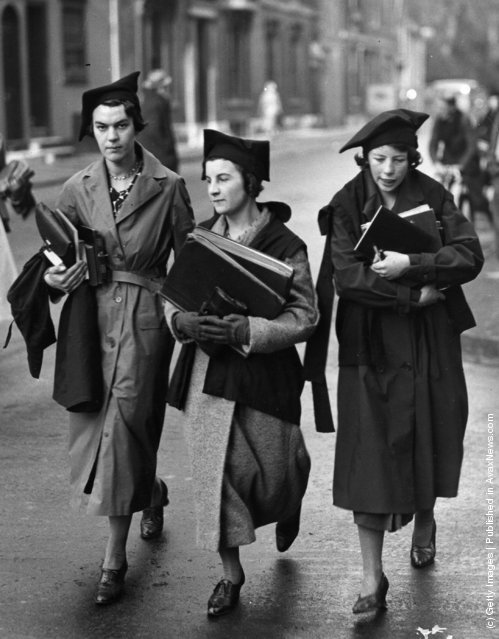 1938: Undergraduates of Oxford University walking to lectures, well equipped with books
