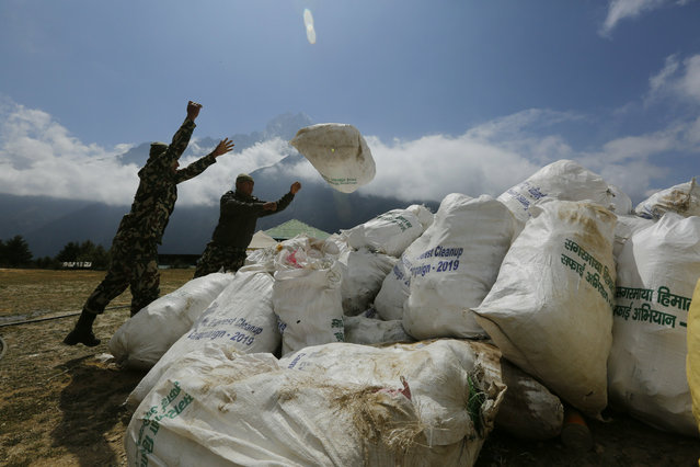 Nepalese army men pile up the garbage collected from Mount Everest in Namche Bajar, Solukhumbu district, Nepal, Monday, May 27, 2019. The garbage will be sent to Kathmandu for recycling. (Photo by Niranjan Shrestha/AP Photo)