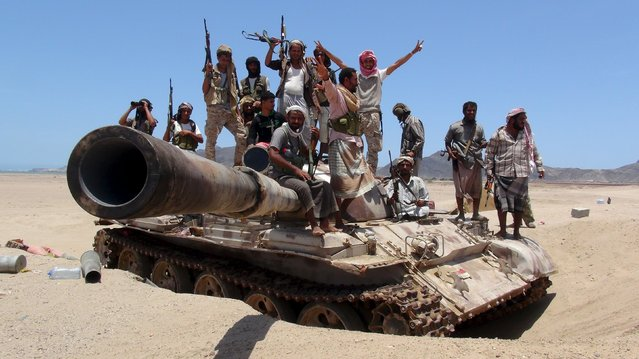 Anti-Houthi fighters of the Southern Popular Resistance stand on a tank in Yemen's southern port city of Aden May 10, 2015. (Photo by Reuters/Stringer)