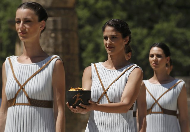 Priestesses attend the Olympic flame lighting ceremony for the Rio 2016 Olympic Games inside the ancient Olympic Stadium on the site of ancient Olympia, Greece, April 21, 2016. (Photo by Yannis Behrakis/Reuters)