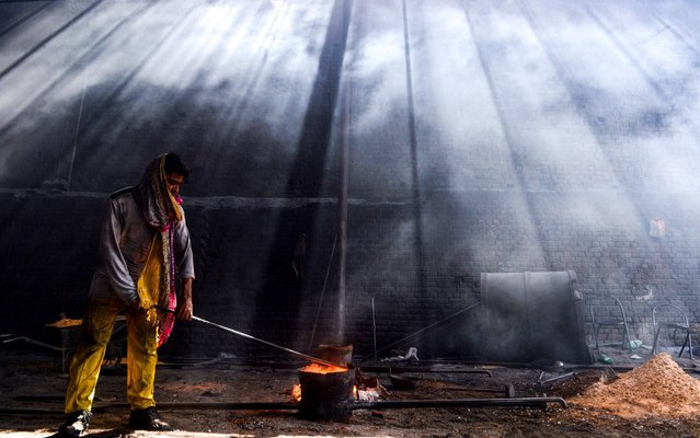 A Pakistani labourer works at an iron factory in Lahore on April 30, 2019, on the eve of the International Labour Day celebrated on May 1. (Photo by Arif Ali/AFP Photo)