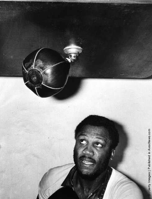 1976: Boxer Joe Frazier hits the punching bag