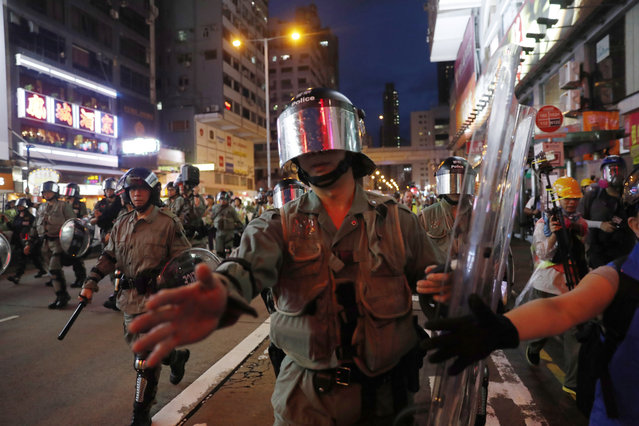 """Riot police advance to disperse anti-government protesters gather outside the Mong Kok Police station after a march themed """"Recover Hung Hom"""" in Mong Kok, Hong Kong, China, 17 August 2019. Hung Hom and To Kwa Wan are popular areas for low-cost travel tours from mainland China. The city braced itself for another weekend of protests demanding the full withdrawal of a now-suspended extradition bill as well as the appointment of a judge-led independent inquiry into police use of force on protesters since June. (Photo by Roman Pilipey/EPA/EFE)"""