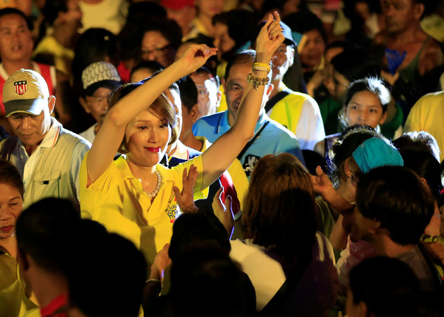 "Geraldine Roman, a transgender congressional candidate, gestures at the crowd during a ""Miting de Avance"" (last political campaign rally) for the national election in Orani town, Bataan province, north of Manila in the Philippines May 6, 2016. (Photo by Romeo Ranoco/Reuters)"