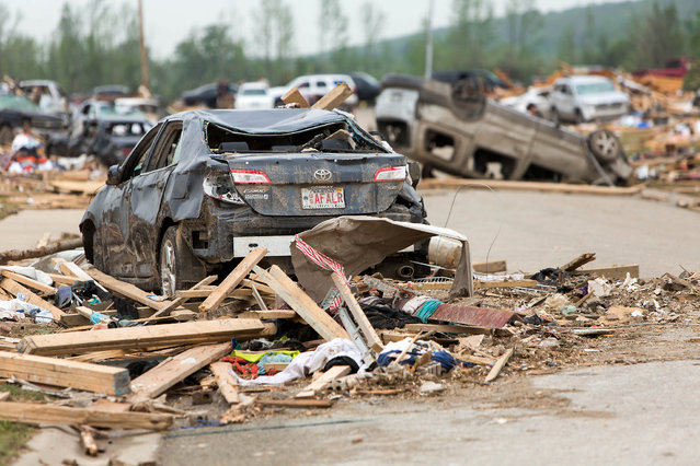 Piles of mangles cars and destroyed homes sit along Aspen Creek Drive in the Parkwood Neighborhood off Naylor Road in Vilonia, Ark., Monday, April 28, 2014 after a tornado struck the town late Sunday. (Photo by Karen E. Segrave/AP Photo)