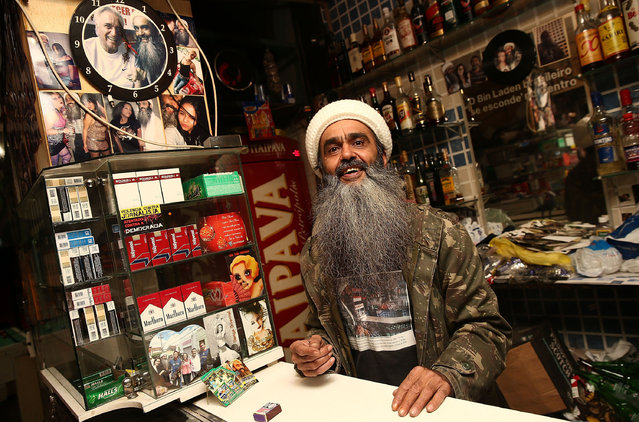 """Osama bin Laden lookalike Ceara Francisco Helder Braga Fernandes poses in his """"Bar do Bin Laden"""" on April 29, 2014 in Sao Paulo, Brazil. Braga says he was known as the """"Beard Man"""" before 9/11 but became known as a Bin Laden lookalike following the 9/11 attacks. He says he is Christian and continues to play the role to support his business. (Photo by Mario Tama/Getty Images)"""