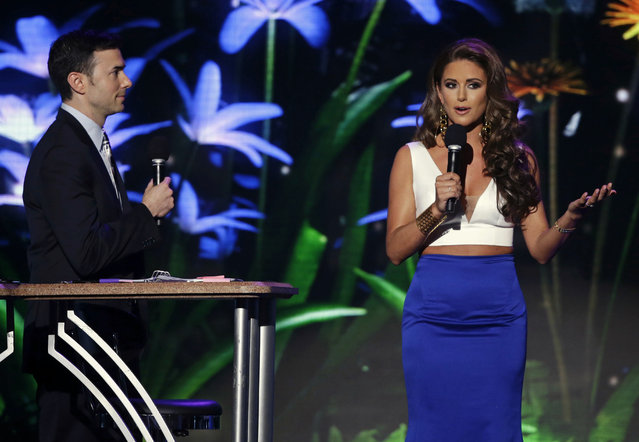 Nick Teplitz, left, and Miss USA 2014 Nia Sanchez co-host the preliminary round of the Miss USA Pageant in Baton Rouge, La., Wednesday, July 8, 2015. (Photo by Gerald Herbert/AP Photo)