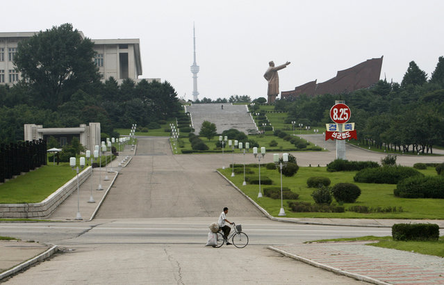 A man transports goods with his bicycle in Pyongyang August 26, 2007. (Photo by Reinhard Krause/Reuters)