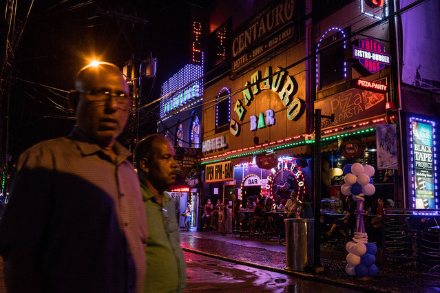 A scene from Fields Avenue, the red light district in Angeles City, notorious for its s*x tourism. (Photo by Hannah Reyes Morales/The Washington Post)