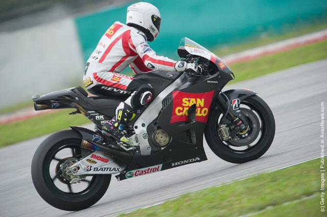 Alvaro Bautista of Spain and San Carlo Honda Gresini heads down a straight during the third day of MotoGP testing at Sepang Circuit