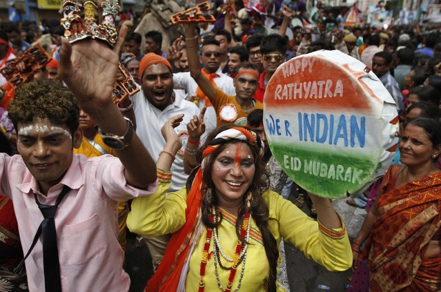 "Indian Hindu devotees dance during the ""Jagannath Rath Yatra"" or the chariot festival of Lord Jagannath in Ahmadabad, India, Saturday, July 18, 2015. (Photo by Ajit Solanki/AP Photo)"